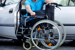 Handicapped driver. A handicapped car driver with a wheelchair Stock Image
