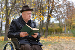 Handicapped elderly man in a wheelchair Stock Photos