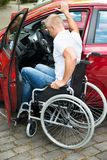Handicapped man boarding in his car Stock Photos