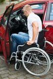 Handicapped man boarding in his car Stock Image