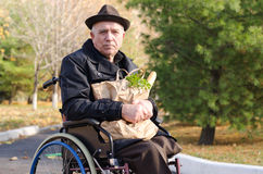 Handicapped man doing his grocery shopping royalty free stock photos