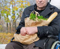 Handicapped man doing his grocery shopping Stock Images