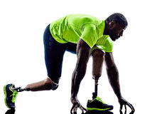 Handicapped man joggers starting line legs prosthesis silhouette Stock Photography