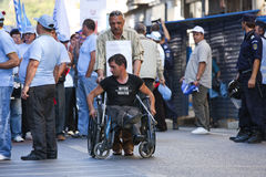 Handicapped Man at the National Unit Wage Protest Stock Image