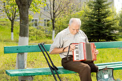 Handicapped man playing the accordion Royalty Free Stock Photo