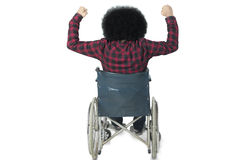 Handicapped man raising hands in the studio Stock Photography