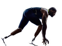 Handicapped man runners sprinters with leg prosthesis. One muscular handicapped man sprints with leg prosthesis on white background Royalty Free Stock Photography