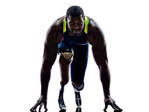 Handicapped man runners sprinters  with legs prosthesis  silhoue Royalty Free Stock Images