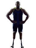 Handicapped man runners sprinters standing legs prosthesis silho. One muscular handicapped man runners sprinters standing with legs prosthesis in silhouette on Stock Images
