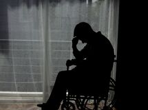 Free Handicapped Man Sitting On Wheelchair In Front Of A Large Panoramic Window In Hospital Stock Images - 187649924