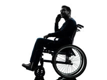 Handicapped man on the telephone in wheelchair silhouette Royalty Free Stock Photos