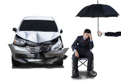 Handicapped man with umbrella and car Stock Photos
