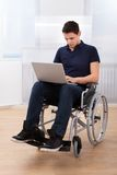 Handicapped Man Using Laptop On Wheelchair Stock Photos