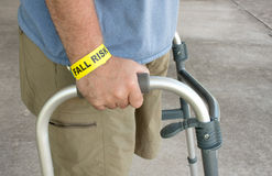 Handicapped Man Wearing A Fall Risk Bracelet Royalty Free Stock Images