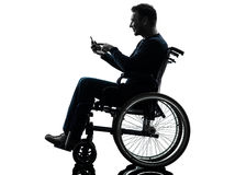 Handicapped man in wheelchair silhouette Stock Image