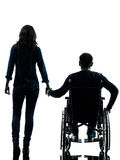 Handicapped man in wheelchair  and woman holding hands silhouett. One handicapped men and women holding hands in silhouette studio  on white background Stock Photos