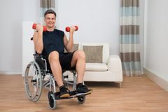 Handicapped man on wheelchair working out Royalty Free Stock Photography
