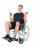 Handicapped man on wheelchair working out Royalty Free Stock Images