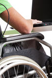 Handicapped man in work. Handicapped man on wheelchair working in office Stock Photo