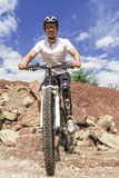 Handicapped Mountain Bike Rider Between Rocks Stock Images