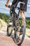 Handicapped mountain bike rider before downhill ride Stock Images