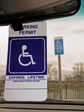 Handicapped parking permit. Handicapped sign in window Royalty Free Stock Photo