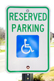 Handicapped Parking Sign. Sign designating a reserved parking space for handicapped persons Stock Photography