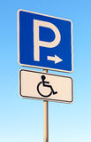 Handicapped parking sign against blue sky Stock Photos