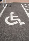 Handicapped parking. Sign of handicap infrastructure. On cement Royalty Free Stock Photo