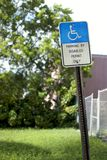 Handicapped Parking Sign - Rusty and Crooked Royalty Free Stock Photography