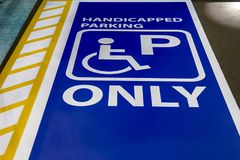 Handicapped parking only sign slot for disable people. Royalty Free Stock Photos