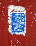 Handicapped parking sign with snow Stock Image