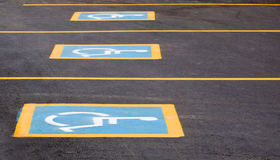 Handicapped parking spaces. Row of parking spaces with a handicapped sign Stock Image