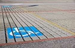 Handicapped parking spot - transportation infrastructure road markings and sign. Royalty Free Stock Photo