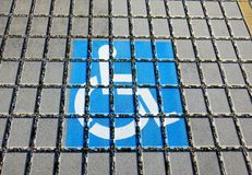 Handicapped parking spot - transportation infrastructure road markings and sign. Stock Photos