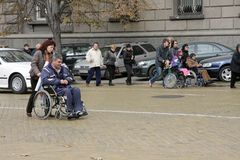 Handicapped people in wheelchairs on a street in the middle of the day in Sofia, Bulgaria – nov 10, 2008. Handicapped people in wheelchairs on a street Stock Photography
