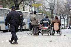 Handicapped people in wheelchairs on a street. Disabled person. Disadvantage people.  Stock Photo