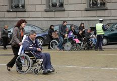 Handicapped people in wheelchairs on a street in the middle of the day in Sofia, Bulgaria – nov 10, 2008. Handicapped people in wheelchairs on a street Stock Images