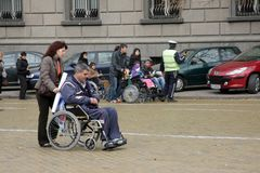 Handicapped people in wheelchairs on a street in the middle of the day in Sofia, Bulgaria – nov 10, 2008 stock photography