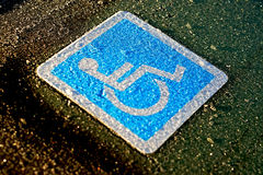 Handicapped person car adhesive label Stock Photography