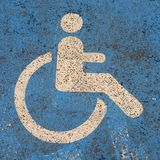 Handicapped person logo. Wheelchair blue and white logo Royalty Free Stock Images