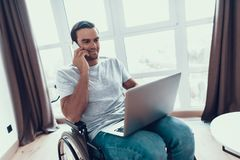 Handicapped Person in Wheelchair Talking Phone royalty free stock photo