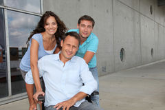 Handicapped person at work. Group of office workers with handicapped person stock photography