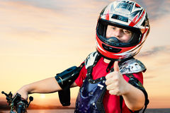 Handicapped quad bike rider doing thumbs up. Royalty Free Stock Images