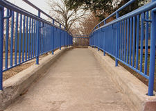Handicapped ramp. With blue rails Stock Image