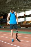 Handicapped Runner on Track in Stadium stock image