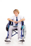 Handicapped school student. Optimistic handicapped high school student sitting on wheelchair Stock Photo