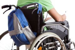 Handicapped schoolboy. A handicapped schoolboy on wheelchair with a backpack Royalty Free Stock Photos