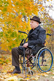 Handicapped senior enjoying the autumn sun Royalty Free Stock Image