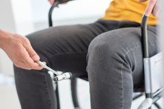Handicapped senior man testing. For knee reflex 2 royalty free stock photography